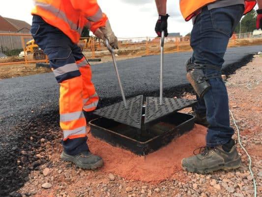 picture of work men installing a heavy duty lid