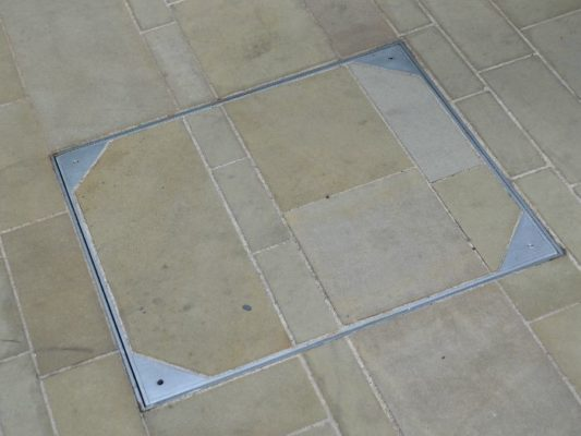 category picture of a driveway block pavior lid with slabs installed over it