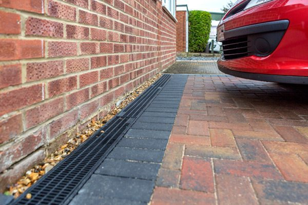 plastic channel drainage installed on a driveway