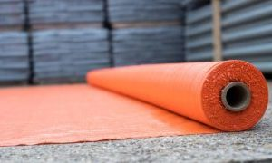 picture of a roll of orange geotextile membrane
